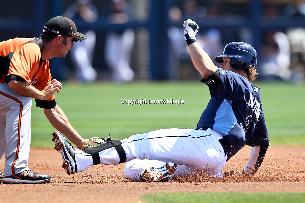 March 20, 2011; Port Charlotte, FL, USA; Tampa Bay Rays third baseman Evan Longoria (3) is tagged out by Baltimore Orioles shortstop J.J. Hardy (2) while trying to advance to second base on a hit during a spring training exhibition game at Charlotte Sports Park.   Mandatory Credit: Derick E. Hingle