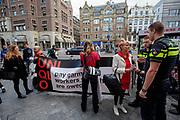 Nederland, Amsterdam, 28-09-2018<br /> De Schone Kleren Campagne voert actie voor de deur van Uniqlo. In 2014 verloren 2000 kledingarbeiders hun baan toen het merk de productie in een fabriek terugtrok, de arbeiders wachten nog steeds op hun ontslagvergoeding. In Amsterdam opent de Japanse modeketen UNIQLO haar eerste vestiging in Nederland. Het bedrijf wordt gezien als de Japanse H&M.<br /> <br /> In Amsterdam Uniqlo opens its first store in The Netherlands. The Japanese fashion brand is seen as the Japanese H&M.<br /> Foto: Bas de Meijer / De Beeldunie