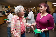 Retired library employee Marjorie Stone (Left) attends the 50th birthday of Alden Library.