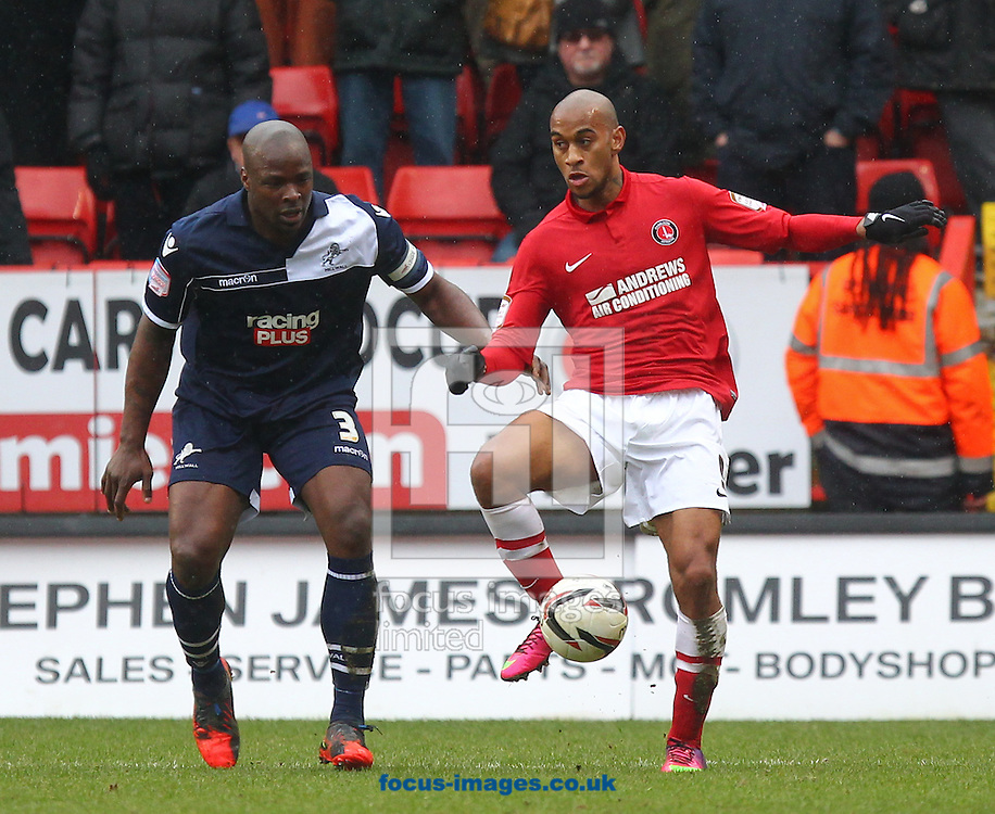 Picture by John  Rainford/Focus Images Ltd +44 7506 538356.16/03/2013.Danny Haynes of Charlton Athletic and Danny Shittu of Millwall during the npower Championship match at The Valley, London.