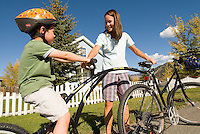 A young woman and her son get ready for a bike ride in Jackson Hole, Wyoming.