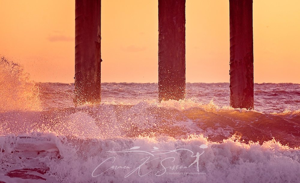 The sun rises on crashing waves at the St. Johns County Pier, March 21, 2016, in St. Augustine, Florida. (Photo by Carmen K. Sisson/Cloudybright)