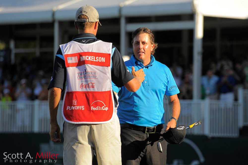 Phil Mickelson (USA) is greeted by his caddy Jim MacKay on the 18th hole during the final round of the PGA Tour Championship the final event of the 2009 FedEx Cup at East Lake Golf Club on Sept. 27, 2009 in Decatur, Ga.     ..©2009 Scott A. Miller