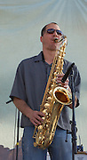 Saxophone playing during the Crawdaddy-o concert at Tucson's first-ever Fiesta en el Barrio Viejo in 2010. The all-day concert is now known as Fiesta en el Barrio. Event photography by Martha Retallick.