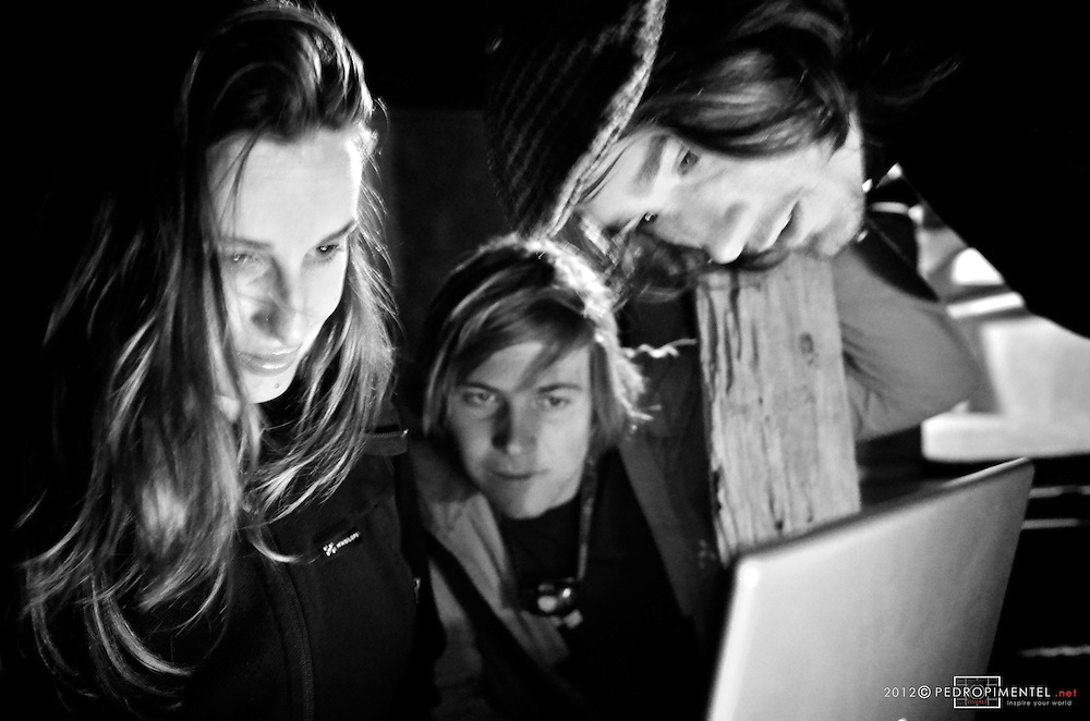 Lisa Carnie, Flo and James review some images from a previews photo shoot.  New Zealand.