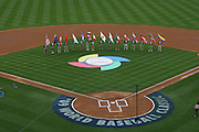 LOS ANGELES, CA - MARCH 22: Flag bearers participate in pregame ceremonies as USA gets ready to play against Japan in game two of the semifinal round of the 2009 World Baseball Classic at Dodger Stadium in Los Angeles, California on Sunday March 22, 2009. Japan defeated USA 9-4. (Photo by Paul Spinelli/WBCI/MLB Photos)