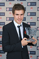 CARDIFF, WALES - Wednesday, November 11, 2009: Wales' Aaron Ramsey with the Welsh Young Player of the Year Trophy during the Football Association of Wales Player of the Year Awards hosted by Brains SA at the Cardiff City Stadium. (Pic by David Rawcliffe/Propaganda)