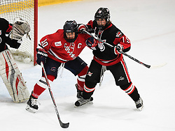 MOON TOWNSHIP, PA - SEPTEMBER 23:  Rikki Meilleur #10 of the Robert Morris Colonials battles with Blaire Allison #15 of the Toronto Jr. Aeros in the first period during the game at the 84 Lumber Arena on September 23, 2016 in Moon Township, Pennsylvania. (Photo by Justin Berl)