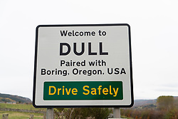 Road sign at Scottish village called Dull near Aberfeldy in Perthshire, Scotland , UK