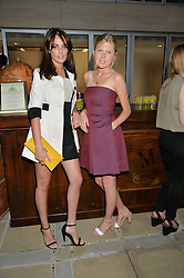 Left to right, LADY VIOLET MANNERS and ROSIE WHITCOMBE at a party to celebrate the launch of Le Jardin de Monsieur Li by Hermes in association with Mr Fogg's was held at Hermes, 155 New Bond Street, London on 9th July 2015.
