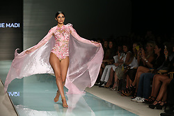 MIAMI, FL - JULY 20: Nick Cannon watches A model walk the runway during Elie Madi at Miami Swim Week Art Hearts Fashion at FUNKSHION Tent on July 20, 2017 in Miami, Florida. 20 Jul 2017 Pictured: ELIE MADI Model. Photo credit: TBA / MEGA TheMegaAgency.com +1 888 505 6342