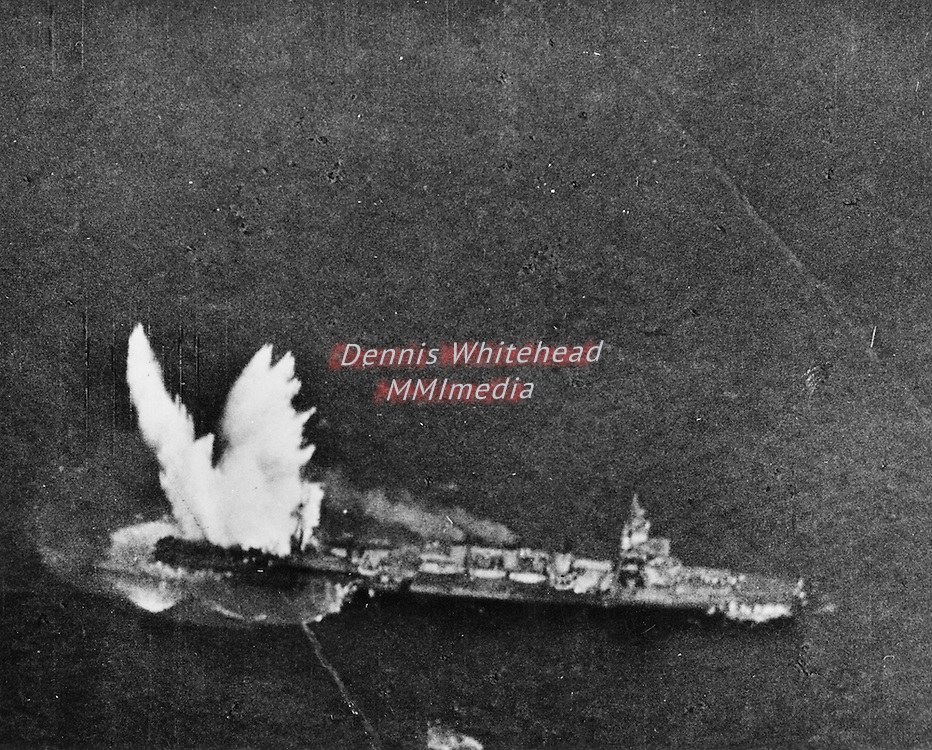 A Japanese cruiser explodes from a torpedo strike by a U.S. Navy Avenger torpedo bomber operating from the first line carrier in the area of the Marshall Islands.