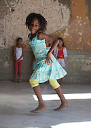 CUBA: Havana. children's fashion for little girls. In a   old decaying house.  the place of the movie, fresa y chocolate. Havana CITY center.  centro Habana.      / Cuba. La Havane.  mode enfantine pour petite filles. dans une  vielle maison bourgeoise et baroque delabree. ou a ete tourne le film fraise et chocolat. La Havane centro,    calle concordia 418 ,
