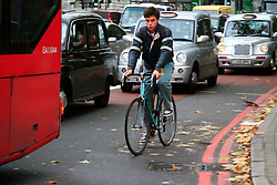 Cyclists dodge through overcrowded roads during London Tube Strike. © under license to London News Pictures. 03/11/2010.Tube Strike, RMT and TSSA members strike over job cuts and safety issues.