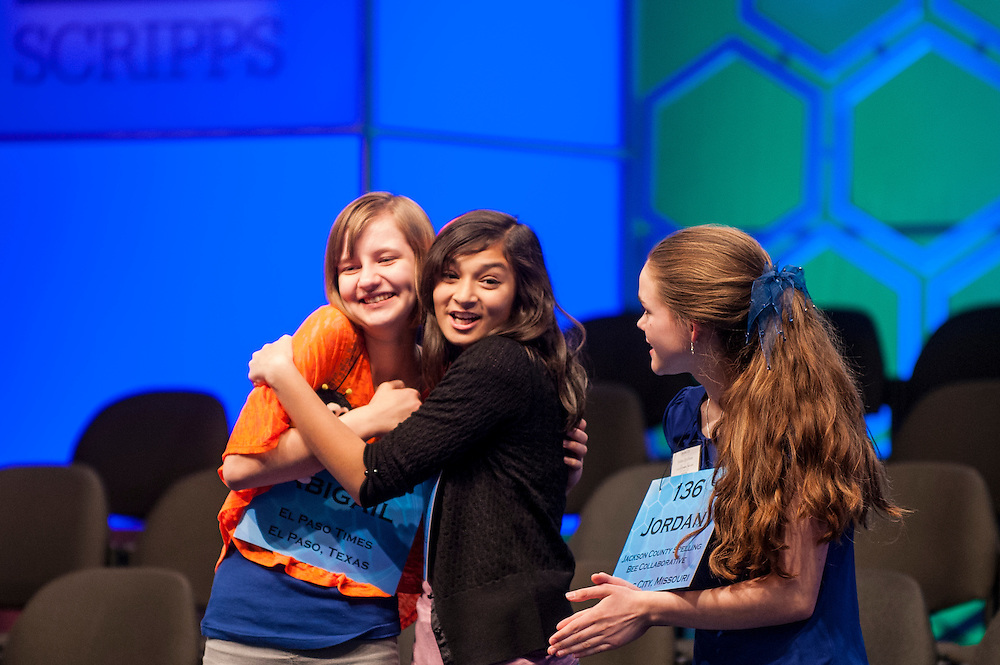 ABIGAIL VIOLET SPITZER, 14, of El Paso, Texas, celebrates with VISMAYA JUI KHARKAR, 13, of Bountiful, UT and JORDAN HOFFMAN, 14 of Lee's Summit, MO, after they are named as semifinalists following round three of the 85th Annual Scripps National Spelling Bee at the Gaylord National Resort & Convention Center in National Harbor, Md., near Washington, D.C.