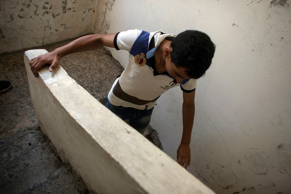 05/07/2013 near Damour, Lebanon: A Syrian refugee runs down the stairwell of an apartment building that was rapidly renovated to accomodate the influx of refugees flooding Lebanon. Estimates have placed the number of Syrian refugees in Lebanon at well over 500,000 people.