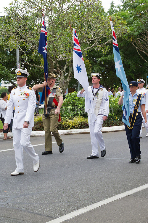 Australian military  marching with flags during Cairns ANZAC Day parade 2010.