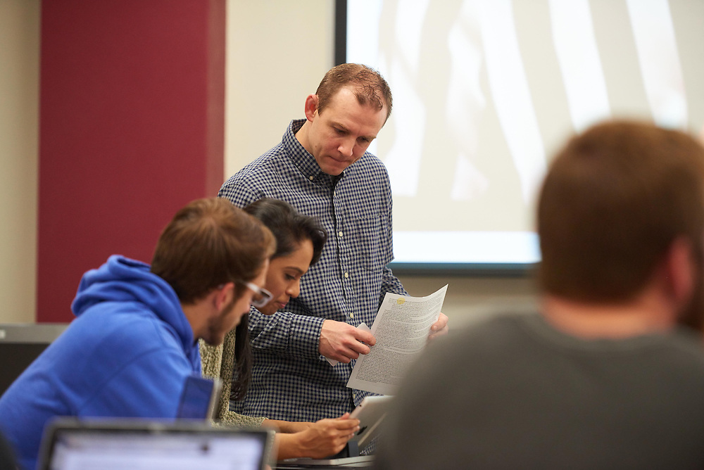 Activity; Speaking; Studying; Talking; Buildings; Murphy Library; Location; Inside; Classroom; Spring; April; People; Professor; Time/Weather; day; Type of Photography; Candid; UWL UW-L UW-La Crosse University of Wisconsin-La Crosse; Man Men