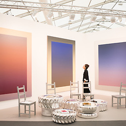 London, UK - 15 October 2014: a woman looks at artworks from the 'Suicide Painting' series by Rob Pruitt during the first day of Frieze Art Fair and Frieze Masters in Regent's Park.