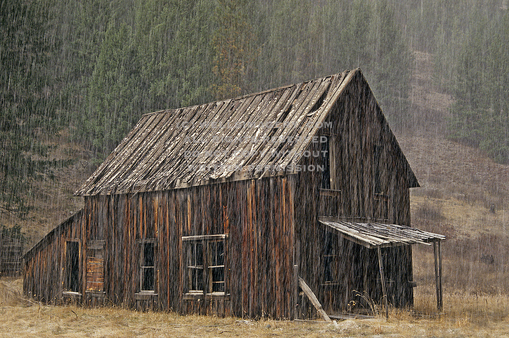 Landscape Photographer and Nature Decor Photography Randy Wells, Image of an old barn during a hailstorm in the ghost town of Bodie, Okanogan, Washington, Pacific Northwest