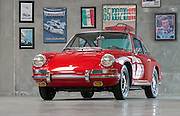 Image of a red Porsche 911 with Porsche memorabilia in southern California, America west coast