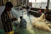 Koli Fishermen preparing nets in Cuffe Parade, a Koli colony near Nariman Point, South Mumbai. Cuffe Parade consists of 1000 families and 350 fishing boats.