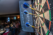 Darts at Kings Head Ravenstonedale Pub & Restaurant, in Yorkshire Dales National Park, near Kirkby Stephen, Cumbria county, England, United Kingdom, Europe. England Coast to Coast hike day 7 of 14. [This image, commissioned by Wilderness Travel, is not available to any other agency providing group travel in the UK, but may otherwise be licensable from Tom Dempsey – please inquire at PhotoSeek.com.]