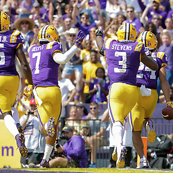 Oct 5, 2019; Baton Rouge, LA, USA; LSU Tigers cornerback Derek Stingley Jr. (24) celebrates with teammates after intercepting a pass against the Utah State Aggies during the first half at Tiger Stadium. Mandatory Credit: Derick E. Hingle-USA TODAY Sports