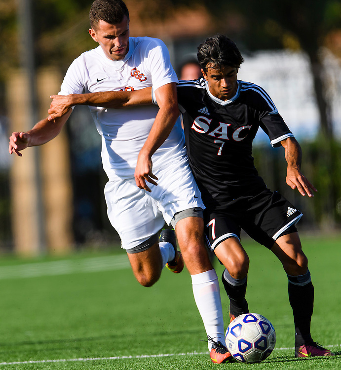 161104 Soccer, NCAA, Santa Ana College - Orange Coast College <br /> Brett Haney, OCC Pirates battling for the ball with Matheus Cuhna, SAC Dons.<br /> &copy; Daniel Malmberg/Sports Shooter Academy 13