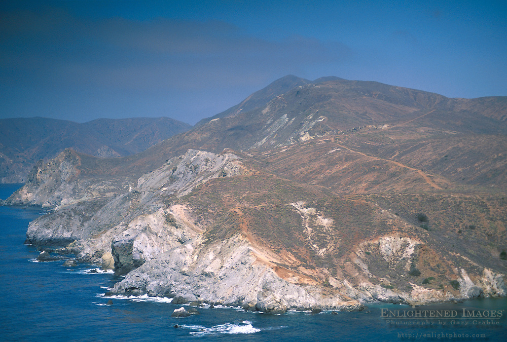 Rugged hills and rocky coastline and blue sky near Little Harbor, Catalina Island coast, California