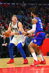 December 21, 2018 - Los Angeles, CA, U.S. - LOS ANGELES, CA - DECEMBER 20: Dallas Mavericks Guard Luka Doncic (77) tries to pump fake Los Angeles Clippers Forward Mike Scott (30) during a NBA game between the Dallas Mavericks and the Los Angeles Clippers on December 20, 2018 at STAPLES Center in Los Angeles, CA. (Photo by Brian Rothmuller/Icon Sportswire) (Credit Image: © Brian Rothmuller/Icon SMI via ZUMA Press)