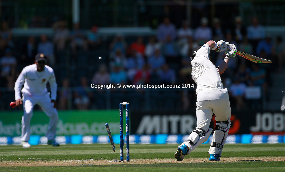 Hamish Rutherford of the Black Caps is bowled by Suranga Lakmal of Sri Lanka on Day 1 of the boxing Day Cricket Test Match between the Black Caps v Sri Lanka at Hagley Oval, Christchurch. 26 December 2014 Photo: Joseph Johnson / www.photosport.co.nz