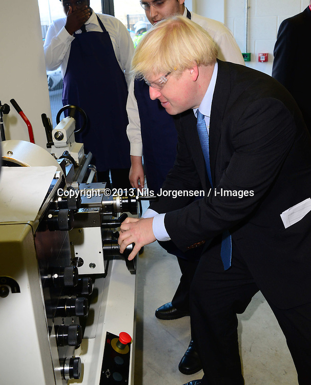 The Duke of York &amp; Boris Johnson College Opening.<br /> Mayor of London Boris Johnson during the opening of the Royal Greenwich University Technical College. The new regional academy will develop the skills of 14-19 year olds in engineering and construction, alongside their core academic education, London, United Kingdom. Thursday, 24th October 2013. Picture by Nils Jorgensen / i-Images