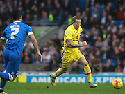 MK Dons midfielder Carl Baker races for the ball during the Sky Bet Championship match between Brighton and Hove Albion and Milton Keynes Dons at the American Express Community Stadium, Brighton and Hove, England on 7 November 2015. Photo by Bennett Dean.