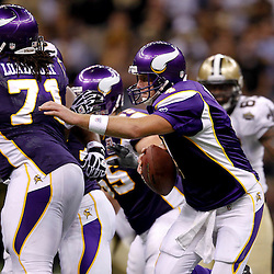 September 9, 2010; New Orleans, LA, USA; Minnesota Vikings quarterback Brett Favre (4) avoids pressure from the New Orleans Saints defense during the NFL Kickoff season opener at the Louisiana Superdome. The New Orleans Saints defeated the Minnesota Vikings 14-9.  Mandatory Credit: Derick E. Hingle