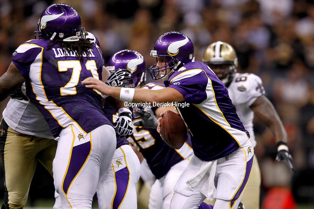 September 9, 2010; New Orleans, LA, USA; Minnesota Vikings quarterback Brett Favre (4) avoids pressure from the New Orleans Saints defense during the NFL Kickoff season opener at the Louisiana Superdome. The New Orleans Saints defeated the Minnesota Vikings 14-9.  Mandatory Credit: Derick E. Hingle