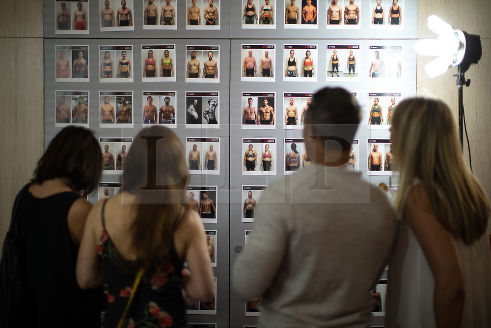 © Licensed to London News Pictures . 31/07/2017 . Manchester , UK . Guests look at displays at the opening event for Up Gym in Spinningfields . Photo credit : Joel Goodman/LNP