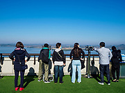 PAJU, GYEONGGI, SOUTH KOREA: South Korean tourists look into North Korea from the Odusan Unification Observatory, a South Korean tourist attraction that overlooks the DMZ. Tourism to the Korean DeMilitarized Zone (DMZ) has increased as the pace of talks between South Korea, North Korea and the United States has increased. Some tours are sold out days in advance.      PHOTO BY JACK KURTZ