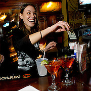 Syracuse, NY / 2004 - Trish Munier serves up martinis during happy hour at Downtown Manhattan bar in Hanover Square. Photo by Mike Roy / For The Syracuse Post-Standard