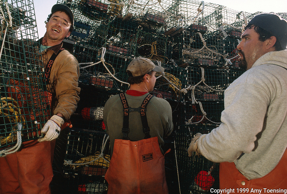 MONHEGAN ISLAND, MAINE - DECEMBER 03: Lobstermen work together to set their traps on trap day, December 3, 1999 on Monhegan Island, Maine. Monhegan Island, home to lobstermen and painters and a popular destination for tourists is twelve miles off the coast of Maine. Ringed by high, dark cliffs, its interior a mix of meadows, marsh and spruce groves, Monhegan is one of just 14 true island communities left off the coast of Maine. The island has a 65 permanent, year-round residents and the population grows to around 200 in the summer, with day-trippers adding several hundred more. (Photo by Amy Toensing) _________________________________________<br />