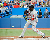 Jul 23, 2014; Toronto, Ontario, CAN; Red Sox designated hitter David Ortiz (34) hits home run to score 3 in first innings against Toronto Blue Jays at Rogers Centre. Mandatory Credit: Peter Llewellyn-USA TODAY Sports