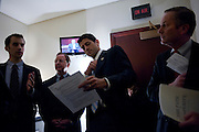 """House Budget Chairman PAUL RYAN (R-WI), (center) listens as his staffer KEVIN SIEFERT preps a group of House Republicans for a news conference to unveil their FY2012 budget resolution they are calling """"Path to Prosperity.'"""