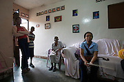 "Viola player Andri at home with her grandmother and other relatives. She learns in Jose? Marti? Bolivarian school at the Barrio Sarria, one of Caracas' poor quarters, home to the ""Nucleo Sarria of the ""Fundacion del Estado para el Sistema Nacional de las Orquestas Juveniles e Infantiles de Venezuela"" (FESNOJIV, National Network of Youth and Children Orchestras of Venezuela). This organization is also known as El Sistema, is a publicly financed private-sector music-education program in Venezuela, originally called Social Action for Music, founded 1975 by Venezuelan economist and amateur musician Jose? Antonio Abreu."