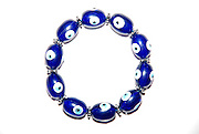 A bracelet with magic eyes used to ward off the evil eye and spirits on white background