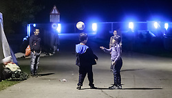 27.09.2015, Grenzübergang, Salzburg, AUT, Fluechtlingskrise in der EU, im Bild Flüchtlinge warten an der Grenze zu Deutschland und schlafen am Boden oder in Zelten, Kinder spielen Fussball // Refugees wait on the border to Germany and to sleep on the ground or in tents, Kids play Football. Thousands of refugees fleeing violence and persecution in their own countries continue to make their way toward the EU, border crossing, Salzburg, Austria on 27.09.2015. EXPA Pictures © 2015, PhotoCredit: EXPA/ JFK