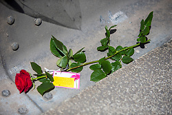 © Licensed to London News Pictures. 26/04/2016. London, UK.  A rose is seen next to  newly installed security barriers  after being handed out members of the 1000RosesLondon group on London Bridge a week after a terror attack killed eight people. The group hopes to promote love and solidarity. Photo credit: Cliff Hide/LNP