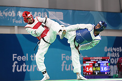 BUENOS AIRES, Oct. 12, 2018  Mohammadali Khosrarvi (L) of Iran competes with Nisar Ahmad Abdul Rahimzai of Afghanistan during the men's +73kg semifinal of taekwondo event at the 2018 Summer Youth Olympic Games in Buenos Aires, Argentina on Oct. 11, 2018. Nisar Ahmad Abdul Rahimzai lost 16-19 and took the bronze. (Credit Image: © Li Ming/Xinhua via ZUMA Wire)