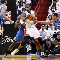 19 June 2012: Oklahoma City Thunder center Kendrick Perkins (5) and Oklahoma City Thunder shooting guard Thabo Sefolosha (2) defend on Miami Heat power forward Chris Bosh (1) during the first quarter of Game 4 of the 2012 NBA Finals, Thunder at Heat, at the AmericanAirlinesArena, Miami, Florida, USA.