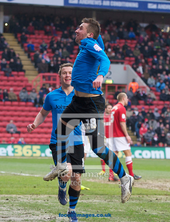Picture by Alan Stanford/Focus Images Ltd +44 7915 056117.23/02/2013.Radoslaw Majewski celebrates scoring his side's their first goal during the npower Championship match at The Valley, London.