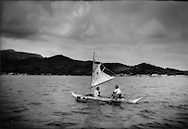 En route to Busuanga Island: Tagbanua villagers navigate the stretch of water between Coron and Busuanga Islands, Philippines.